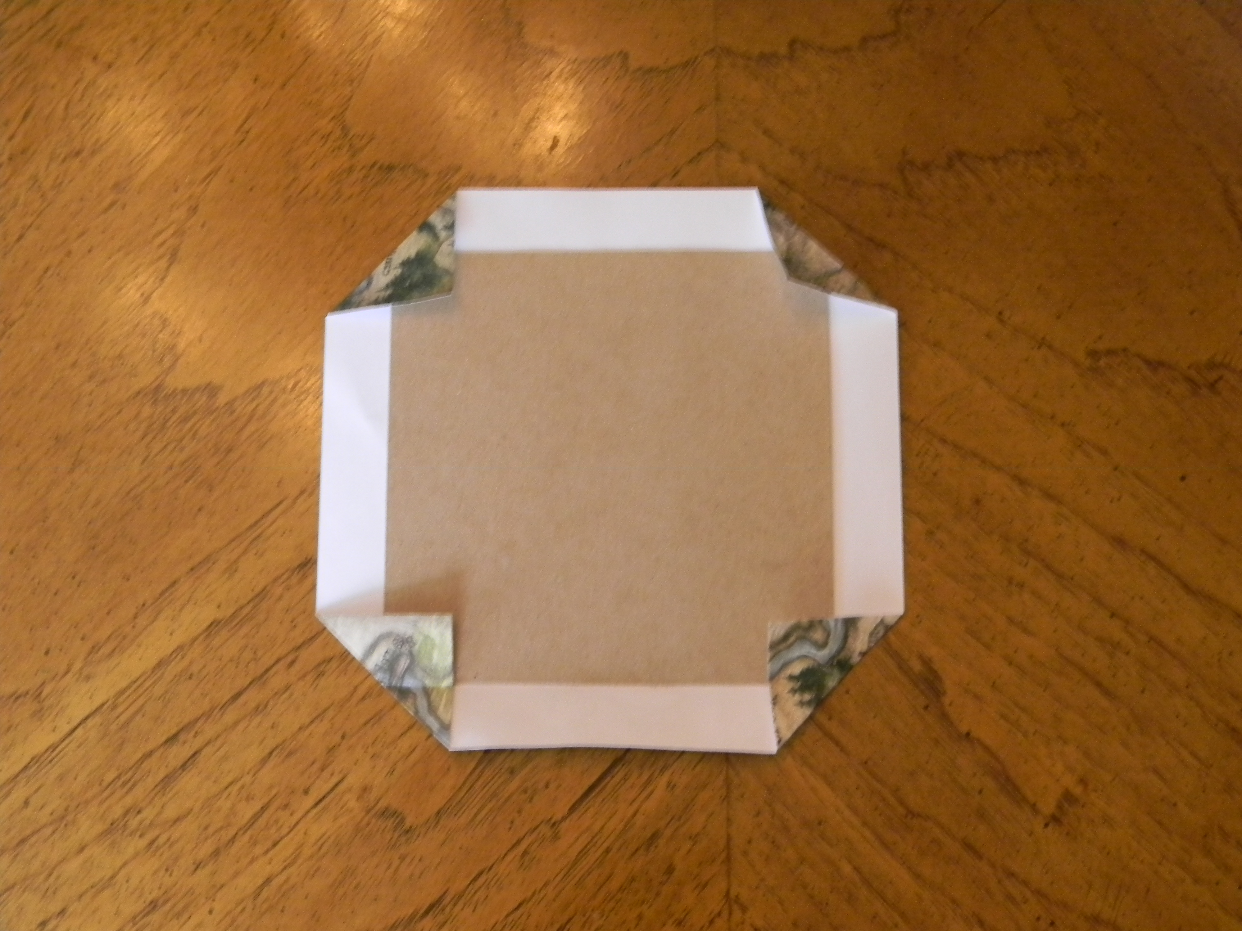 Scrapbook paper booklet - Step 5 Place Chipboard In The Center Of Your 8 Square Of Scrapbook Paper For The Front And Back Covers Fold The Corners In And Glue And Then Fold In The