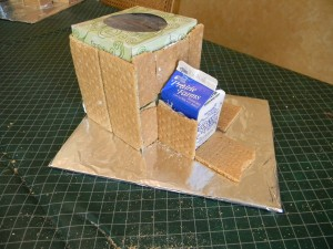 Covering Gingerbread base with grahm crackers