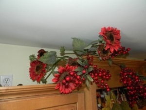 Decorating Above Kitchen Cabinets, adding red sunflowers