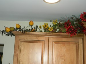 Decorating above kitchen cabinets, left of sink