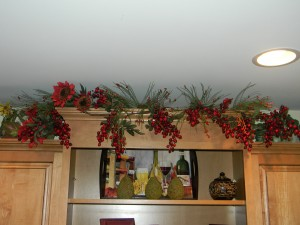 Decorating above kitchen cabinets, berry garlands