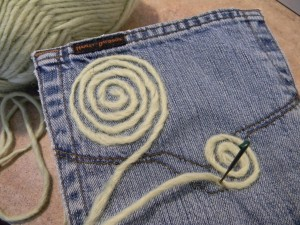 Felting recyceld jean pockets for hanging accessory organizer