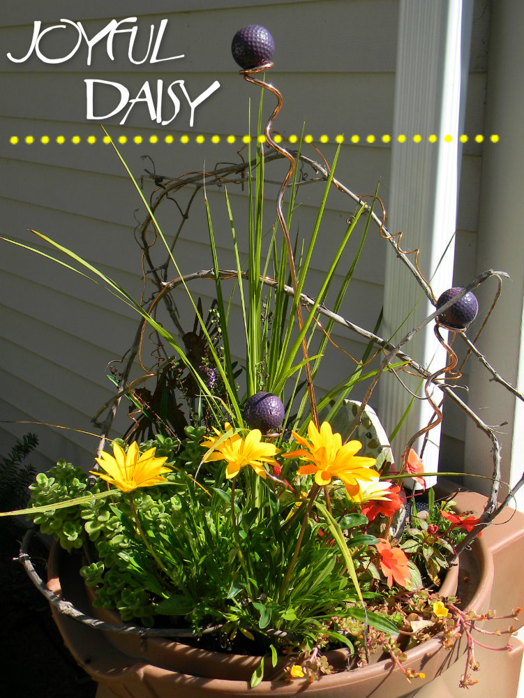 rain barrel adding height to flower arrangements