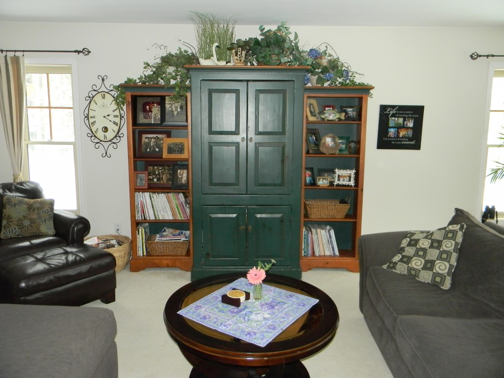 Decorating above tv armoire joyful daisy - How to decorate a family room ...