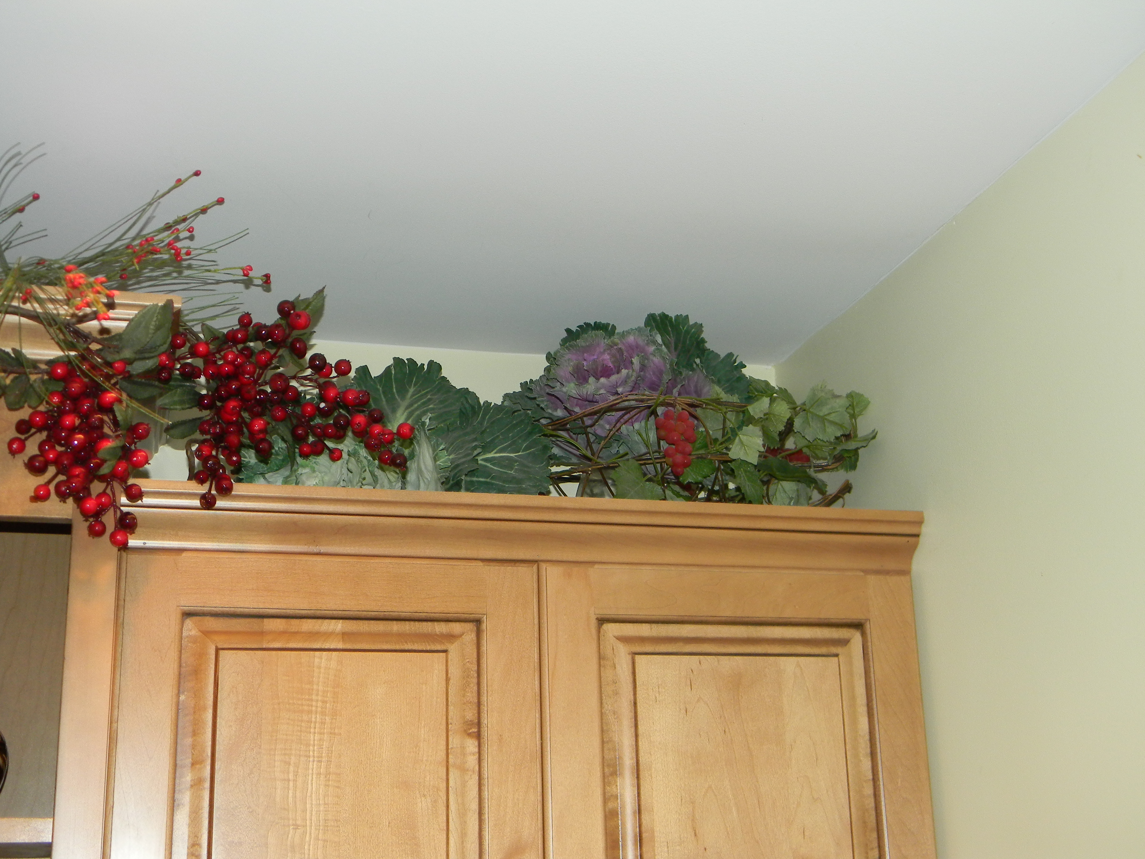 Decorate Above Kitchen Cabinets Html on decorating top of kitchen cabinets, glazed kitchen cabinets, small kitchen ideas with oak cabinets, decorate above shelves, ways to decorate kitchen cabinets, decorate above kitchen counters, decorate above fireplaces, decorate above bookshelves, decorating with plates above cabinets, decorate above kitchen sink, decorate above doors,